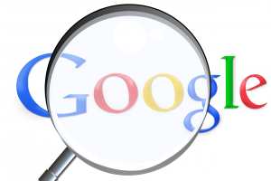 Magnifying glass on Google logo