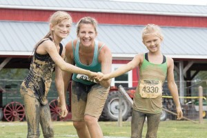 Kim Crup and daughters at Bug Muddy Challenge mud run