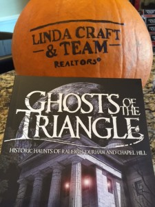 """Linda Craft & Team, REALTORS®"" on pumpkin with ""Ghosts of the Triangle"" book"