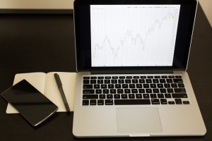laptop with graph of market changes