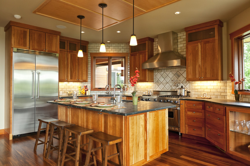 a gourmet kitchen in a luxury home in a gated community