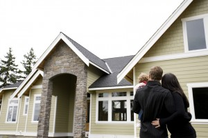 home buyers standing outside of a home for sale