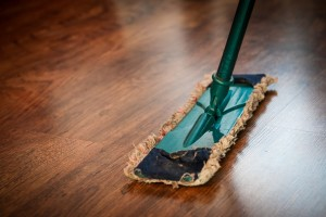a broom sweeping hardwood floors in a home