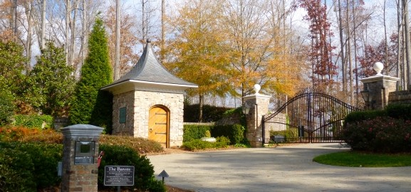 landscaped gated entrance to The Barony neighborhood