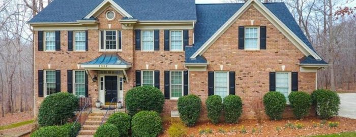 the exterior of a large brick suburban home in raleigh north carolina