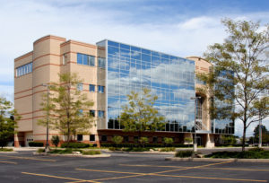 commercial office building with big glass windows