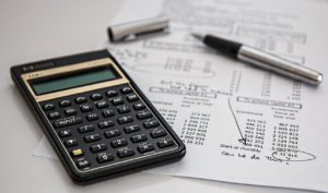 calculator next to list of costs