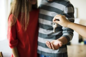 A couple receiving the keys to their new home.