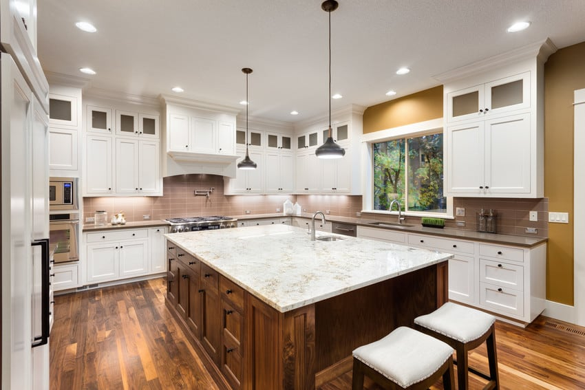 A spacious, luxurious kitchen with a huge island in the center.