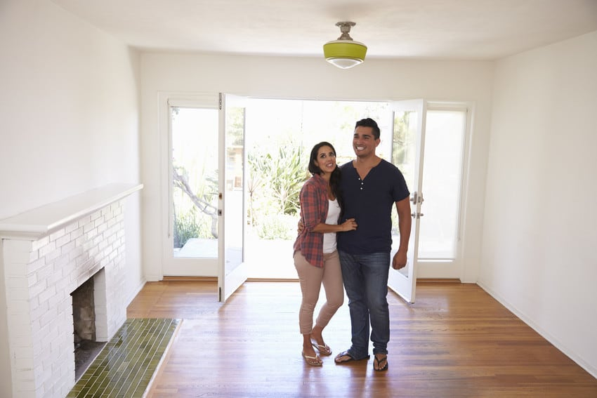 A happy couple excitedly touring their new home.