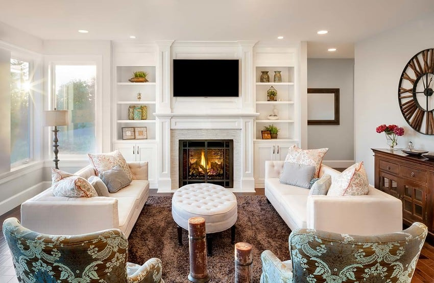 A luxury living room with a fireplace.