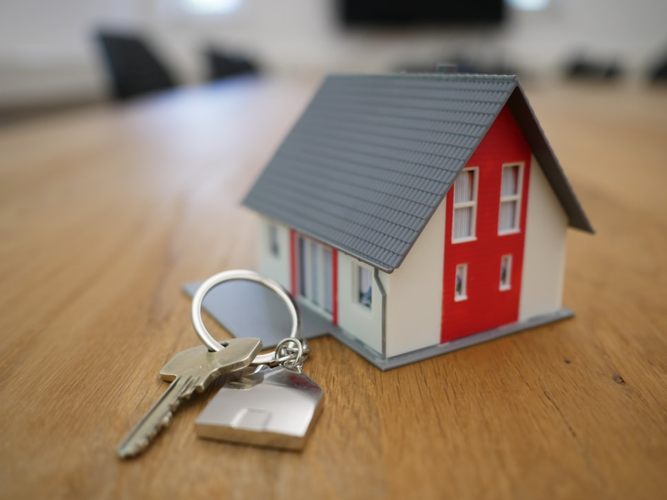 A miniature house and key.
