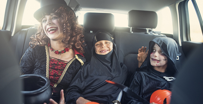 a family drive-through trick or treating