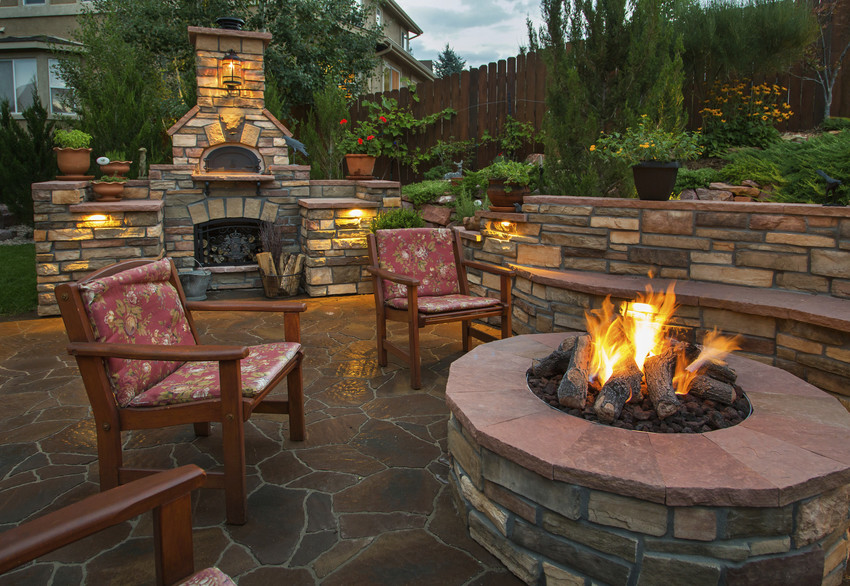 a beautiful outdoor kitchen and fire pit