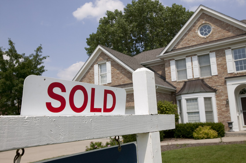 a sold sign on a home