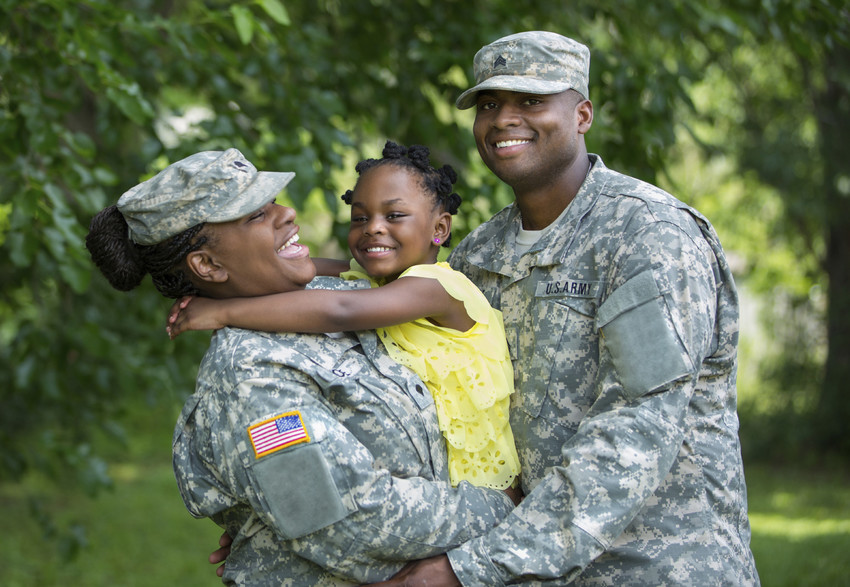 a mother and father in fatigues