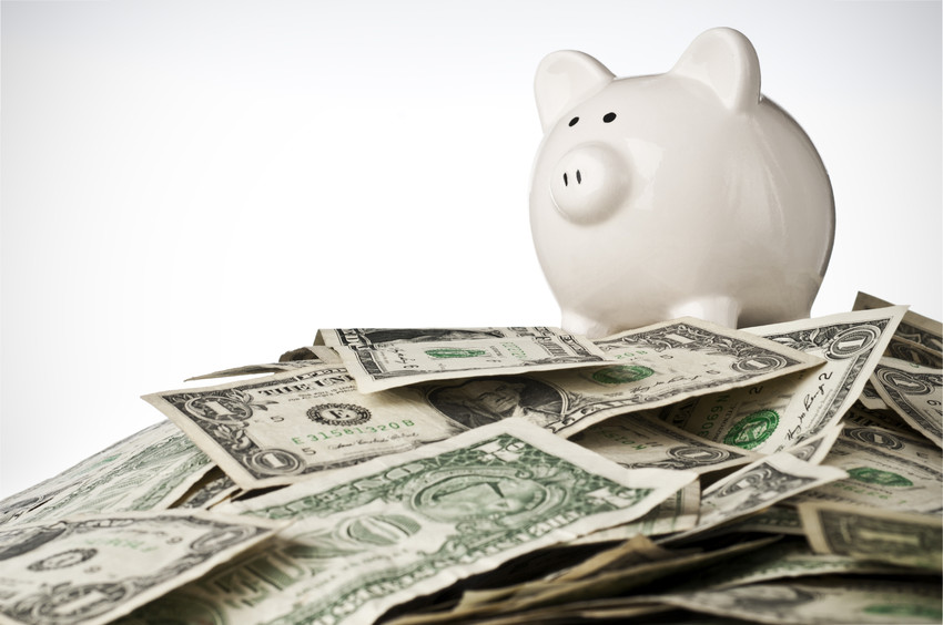 a piggy bank next to a pile of money representing 2020 home equity increase