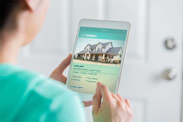 a buyer looking at a home on an ipad