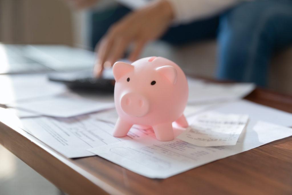 Piggy bank on paperwork