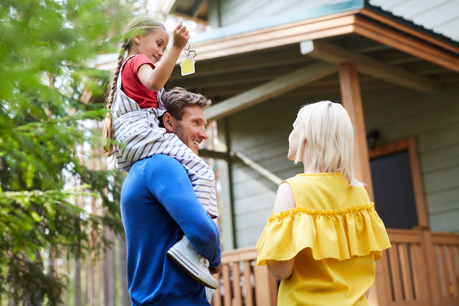 family smiles at new home