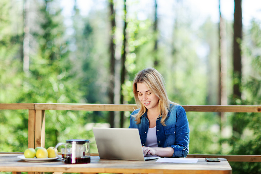 woman on computer researching home equity